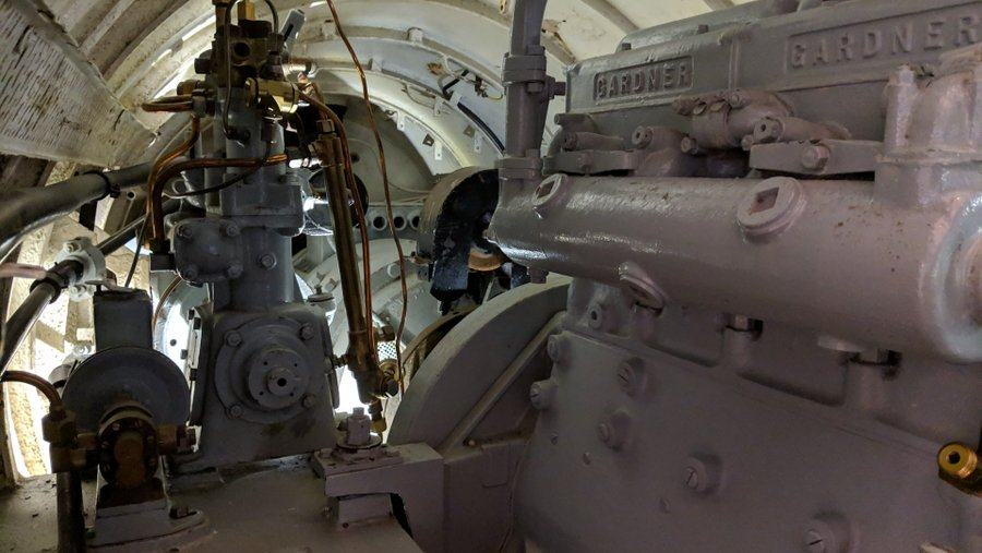 Cramped white-painted engine compartment