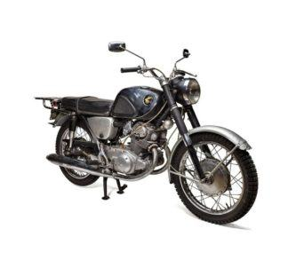 An old Honda motorcycle on a white background