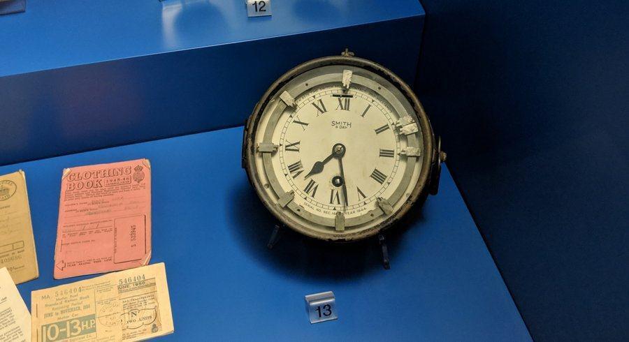 A clock in a blue display case