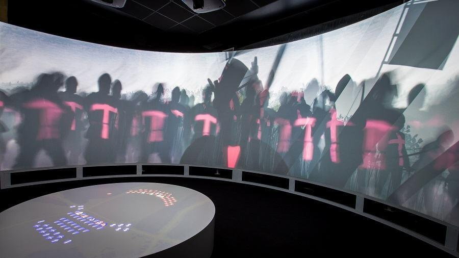 The Agincourt battle experience with shadowy dark silhouettes projected on the wall