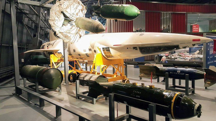 Glass cabinet with a number of bombs, the biggest of which by far is the white rocket-like Blue Steel flying bomb