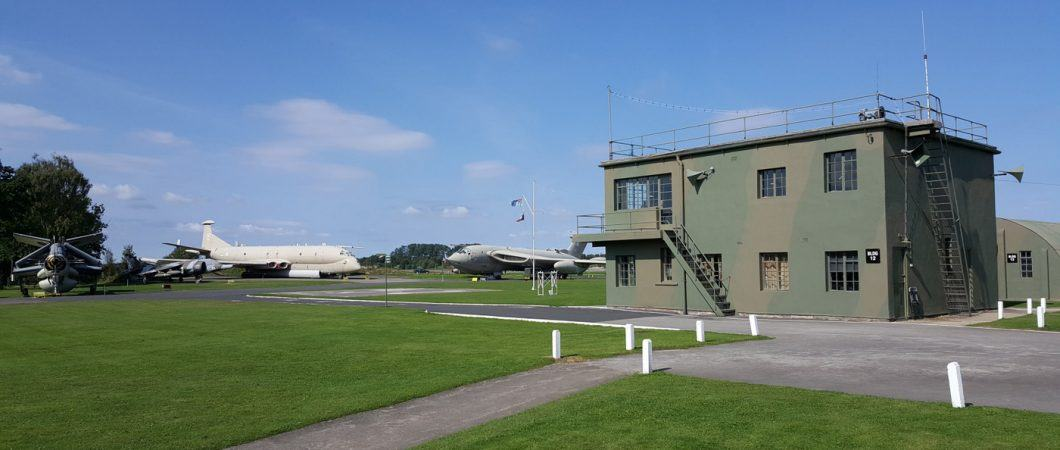 Green & brown camouflaged 1940s control tower