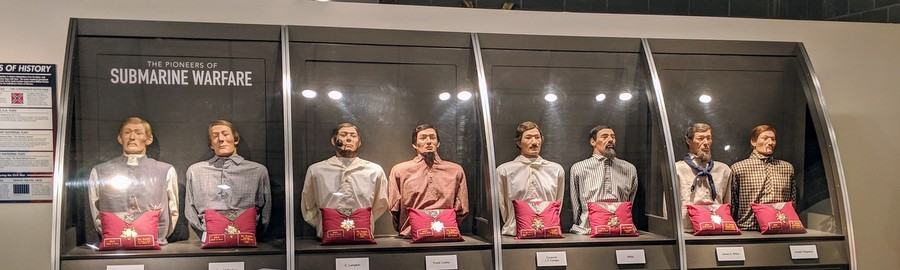 The torsos of eight crew members