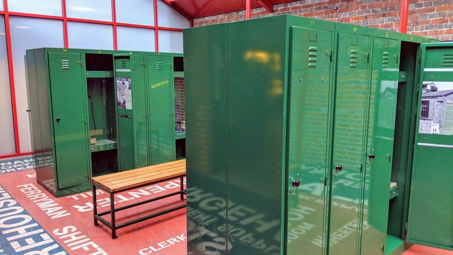 Changing room with green metal lockers