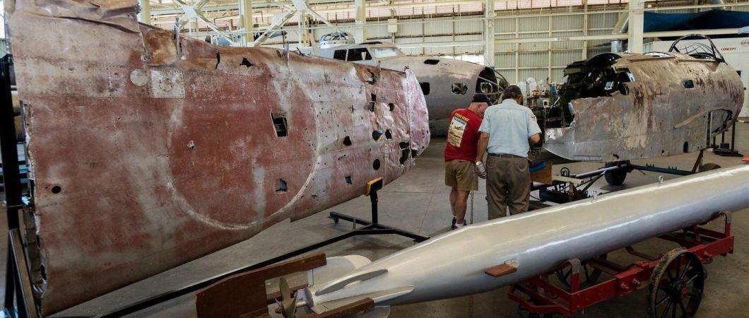 Wing wreckage in restoration workshop