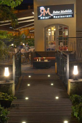 Lights mark the path to the hotel entrance