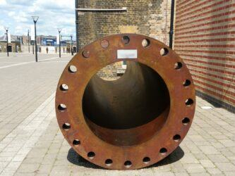 A large steel tube, slightly rusty
